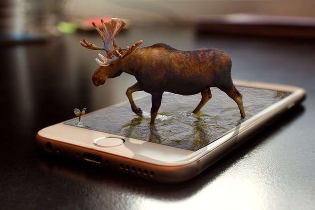 Learn how to design a realistic image of a moose going out of a phone in Adobe Photoshop online