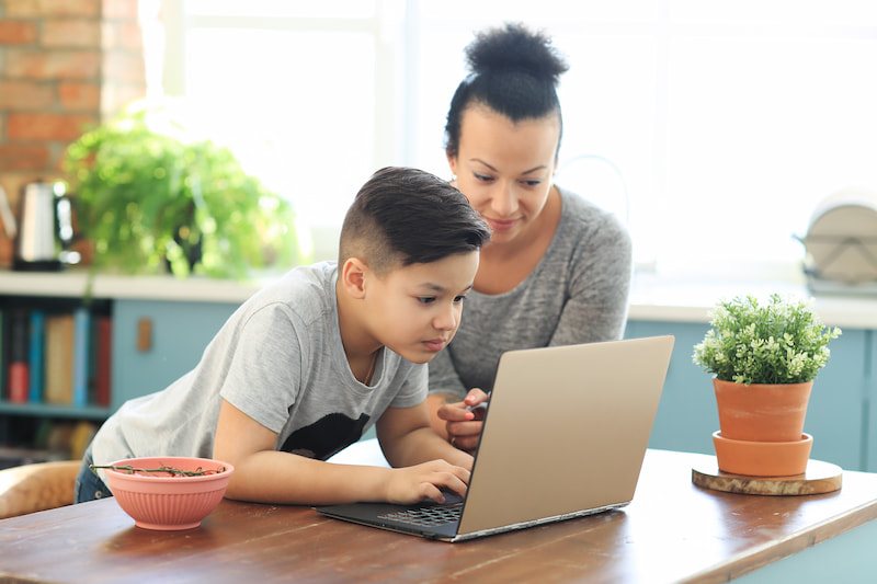 child learning to code at home